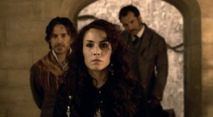 Madame Simza Heron (Noomi Rapace, center) joins forces with Sherlock Holmes (Robert Downey, jr., left) and Doctor Watson (Jude Law, right)