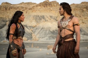 Dejah Thoris (Lynn Collins, left) and John Carter (Taylor Kitsch, right) in the Mars desert.