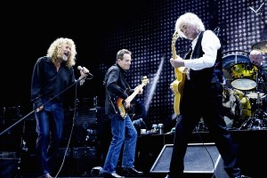 Singer Robert Plant (left), bass player John Paul Jones (center), and guitarist Jimmy Page (right) reunited on stage for the first time in about two decades.