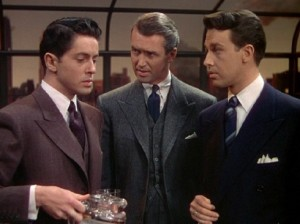 Teacher Rupert Cadell (James Stewart, center) 'interrogates' his students Philip (Farley Granger, left) and Brandon (John Dall, right).