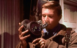 Mark Lewis (Karlheinz Böhm) and his beloved camera.