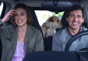 Penny Lockhart (Keira Knightley, left), Dodge Peterson (Steve Carell, right), and their new dog (center) on the final trip of their lives.