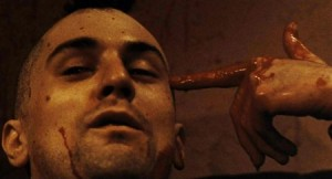 Travis Bickle (Robert De Niro) fails to kill himself.