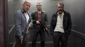 John McClane (Bruce Willis, left), his son Jack (Jai Courtney, center), and Russian refugee Komarov (Sebastian Koch, right) attempt to escape.
