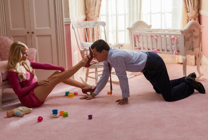 Jordan Belfort (Leonardo DiCaprio, right) may be the Wolf of Wall Street - but at home, 'pussy runs the show' in the shape of his wife Naomi (Margot Robbie, left).