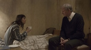 Joe (Charlotte Gainsbourg, left) tells the wise older hermit Seligman (Stellan Starsgård) all about her life as a nymphomaniac.