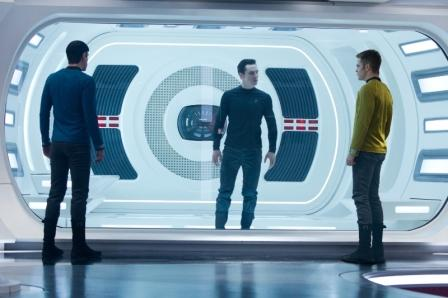Captain James T. Kirk (Chris Pine, right) and his First Officer Spock (Zachary Quinto, left) meet their archenemy Khan Noonian Singh (Benedict Cumberbatch, center).