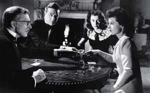 Dr. Scott (Alan Napier), Roderick Fitzgerald (Ray Milland), Stella Meredith (Gail Russell), and Pamela Fitzgerald (Ruth Hussey, from left to right) try to find out what the supernatural events in the haunted house are all about.
